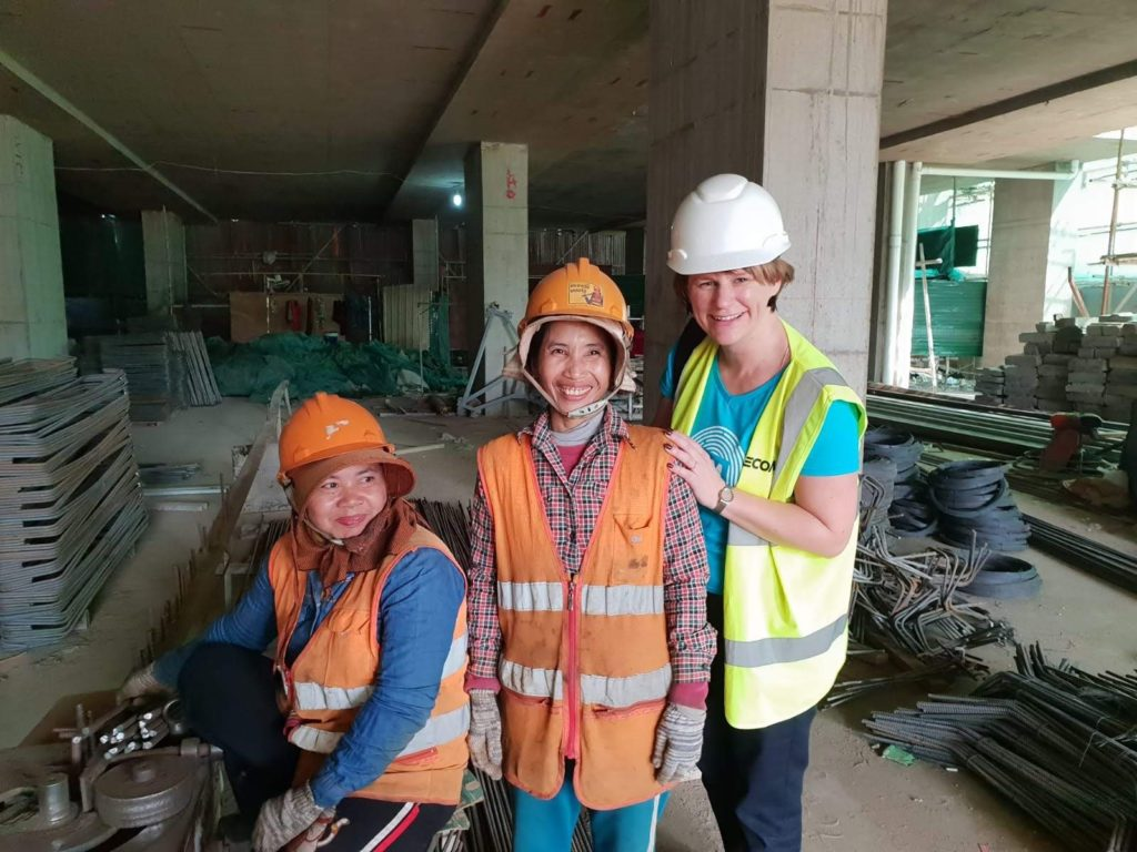 Karen Britton meeting the women responsible for steel bar bending on a construction site in Phnom Penh, Cambodia