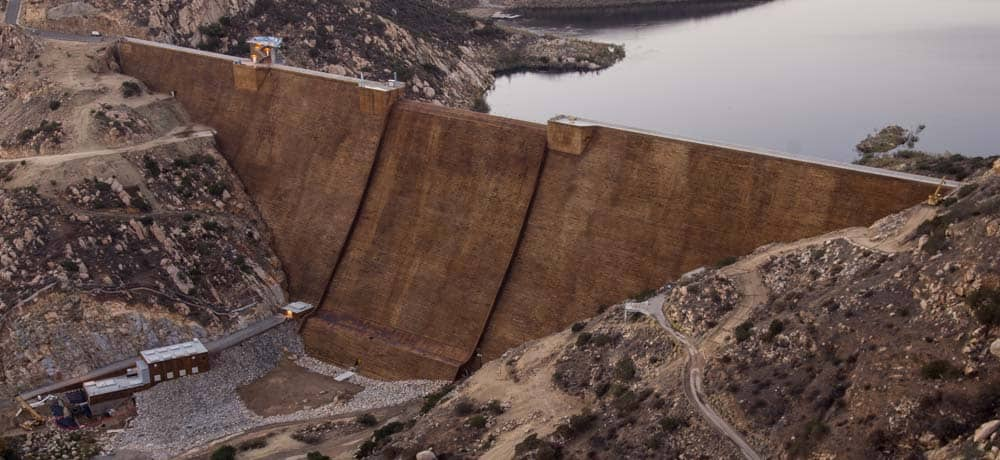 The San Vicente Dam Raise Project, a roller-compacted concrete (RCC) dam raise performed by AECOM (legacy Shimmick), increased the height of the dam by 117 feet, making it the tallest dam raise in the United States and the tallest dam of its type in the world.