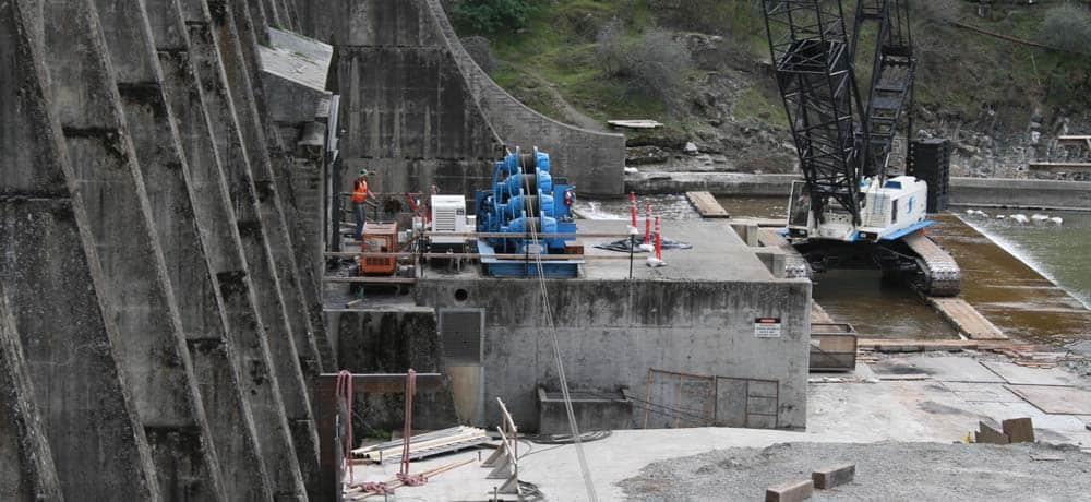 Stony Gorge Dam, a reinforced concrete Ambursen-type dam (concrete slab and buttress), was completed in 1928. It is 868 feet long at the crest, with a structural height of 139 feet. This project, performed by AECOM (legacy Shimmick), increased lateral support of the dam by adding diaphragm walls, additional struts and capital struts.